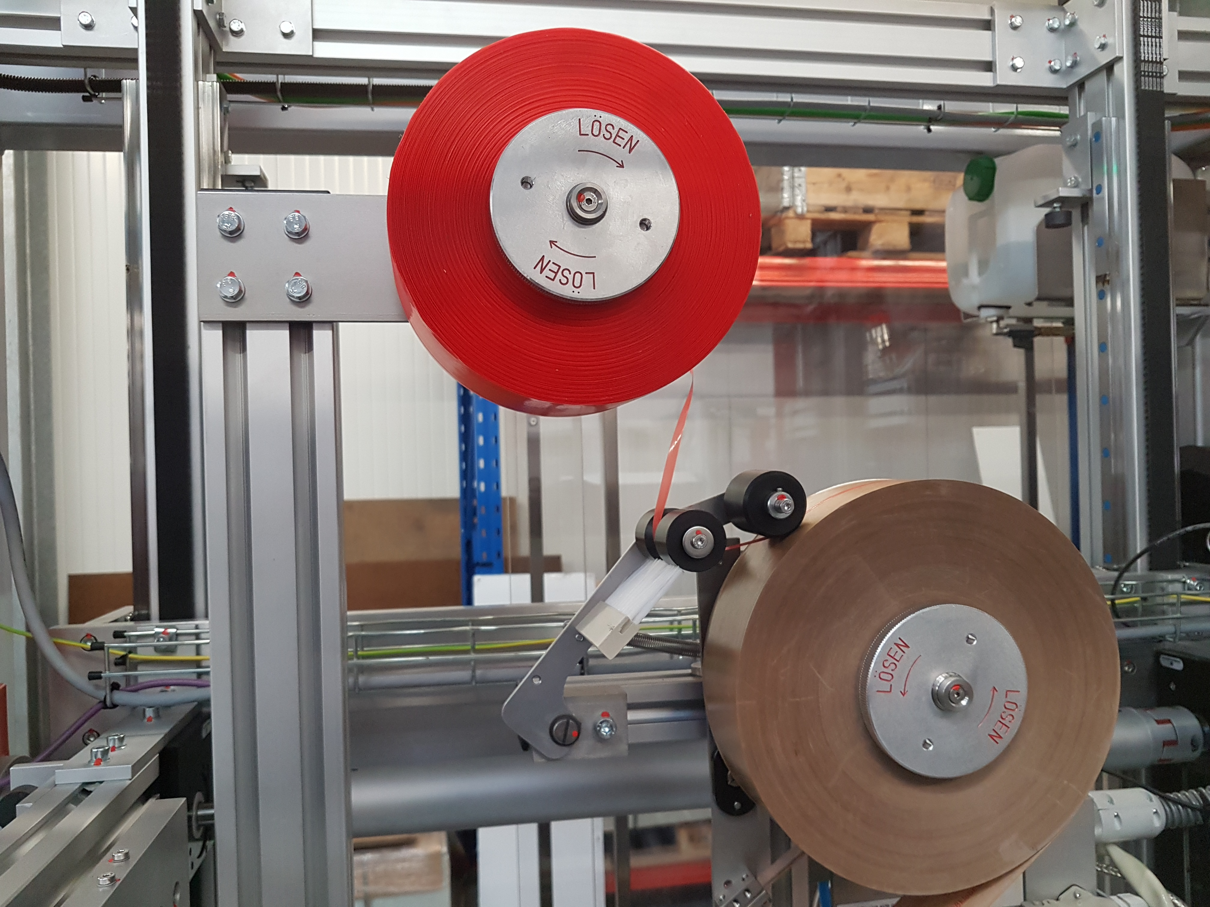 Gummed tape and Knife-free opening strip reels Raupack UK and Ireland
